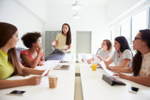 leading the discussion, women in a meeting