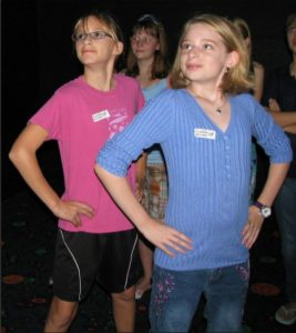 assertive, two girls who are standing confident