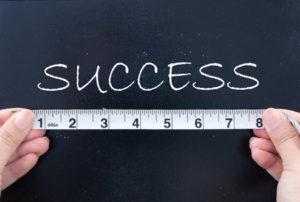 success metrics, measuring tape, success