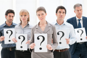 leadership question, employees hold up question marks